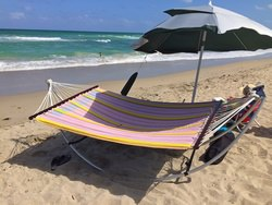 Extra wide full size hammock fabric installed on folding beach hammock stand.