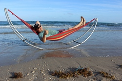 Folding Travel Hammock with Heavy 230 lbs person on a beach.