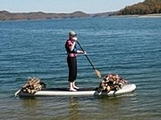 Saturn SUP paddle board great for moving dry wood for camp fire.