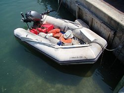 PVC boat left in a marine unprotected under the Sun.