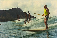 Paddle board surfing in Hawaii.