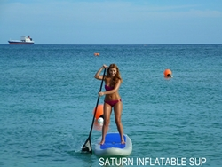 Girl turning inflatable paddle board around