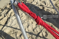 Make knot on hammock fabric loop to make it shorter