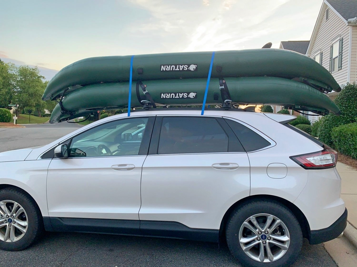 2 Kayaks loaded on top of car
