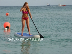 Girl paddling on inflatable sup