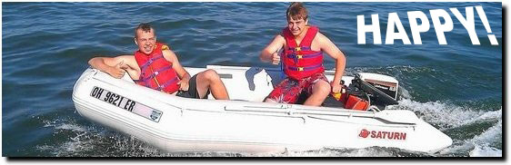 Two boys riding in Saturn 11' inflatable boat and having great time.