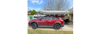 Inflatable Boat loaded on top of car
