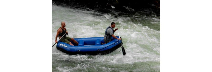 Rafting in river raft with dad