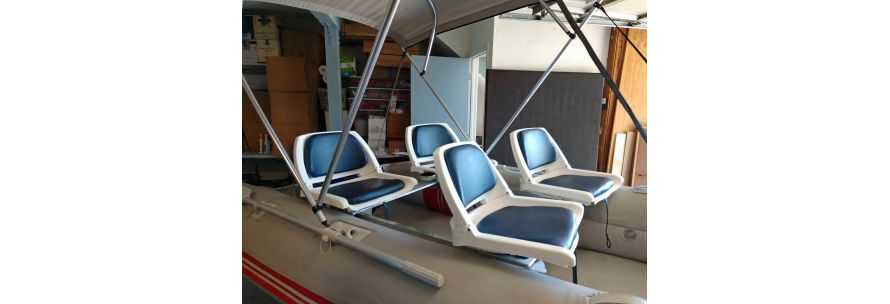 Fishing chair on aluminum bench of inflatable boat
